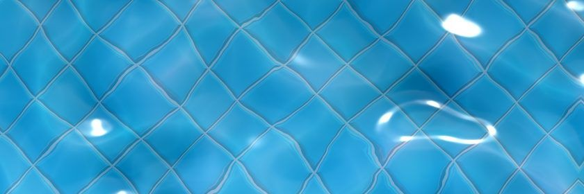 close-up of pool water with floor tiles in the background
